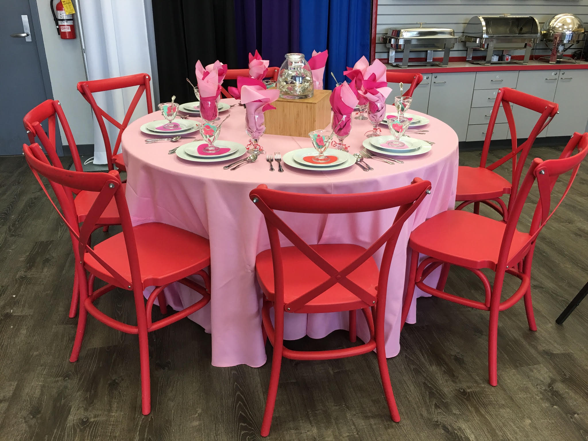 37 red cross back chairs pink tablecloth