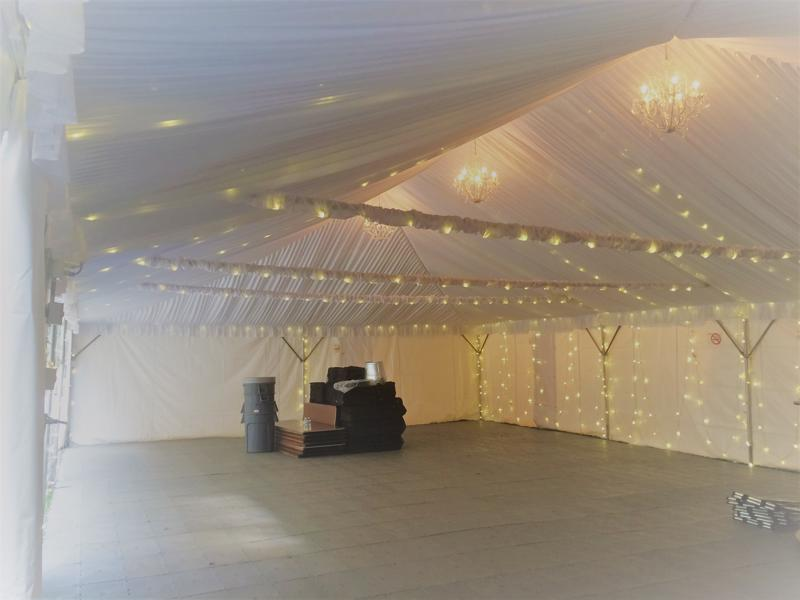 53 tent chandeliers and string lights