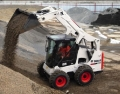 Where to rent LOADER, BOBCAT S-650 w foam tire, diesel in Chicago IL